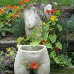 ceramic sculpture of torso situated in her garden in North London